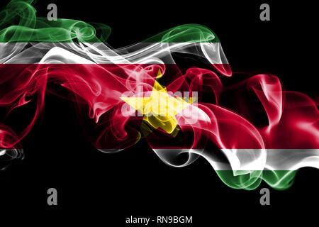 National flag of Suriname made from colored smoke isolated on black background. Abstract silky wave background - Stock Photo