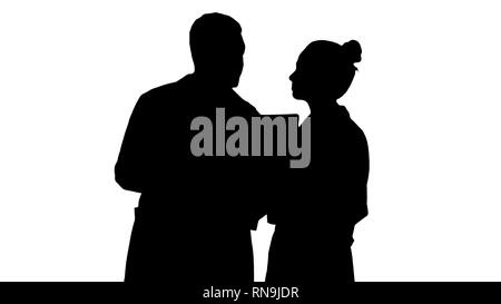 Silhouette Serious nice woman doctor and afro american doctor study brain x ray. - Stock Photo