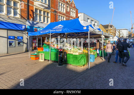 Fruit and vegetable stall in Staines-Upon-Thames Market in High Street, Staines, a town in Spelthorne, Surrey, south-east England, UK - Stock Photo