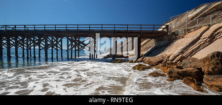 Fishing Pier and boat hoist at Gaviota Beach State Park on the central coast of California United States - Stock Photo