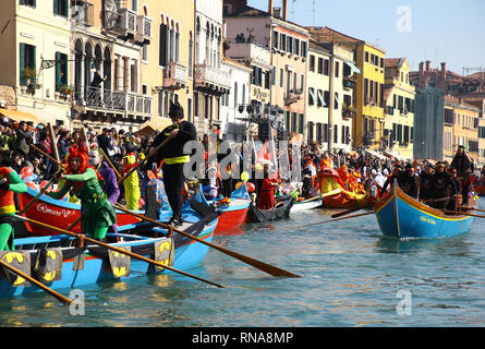 The party of all the Venetians who inaugurates the Carnival, dedicated to citizens and guests of the lagoon city, this year doubles with a double appointment on the foundations of Cannaregio. Sunday, February 17 at 11.00 the water procession of the Coordination Associations Rowing Vogue to the Venetian will drop the moorings from Punta della Dogana along the Grand Canal until you reach the popular Rio di Cannaregio, where it will parade in a blaze of crowded audience on the banks. Upon arrival of the masked marching boats, the eno-gastronomic stands will be opened by AEPE, which will offer the - Stock Photo