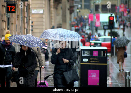 Glasgow, Scotland, UK  18th, February, 2019 UK Weather: Rainy day as locals and tourists enjoy their umbrellas.Credit Gerard Ferry/Alamy Live News - Stock Photo