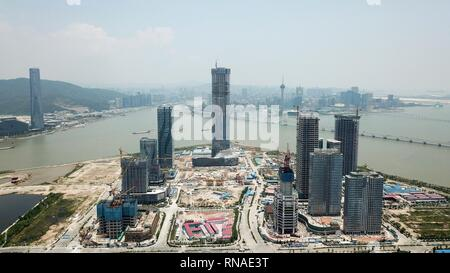 Beijing, China. 23rd May, 2018. Aerial photo taken on May 23, 2018 shows Zhuhai Hengqin International Financial Center under construction and Hengqin new area financial island in south China's Guangdong Province. Credit: Liang Xu/Xinhua/Alamy Live News - Stock Photo