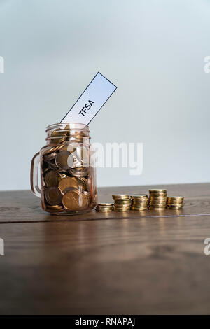 Jar of Coins showing savings to a Tax Free Savings Account - Stock Photo