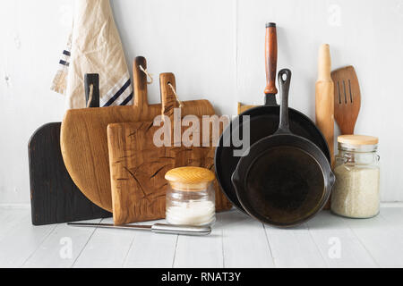 Rustic still life. Set of wooden kitchen utensils on white wooden kitchen table - Stock Photo