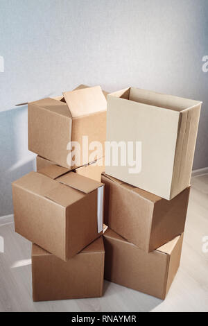 Move. lots of cardboard boxes on background - Stock Photo
