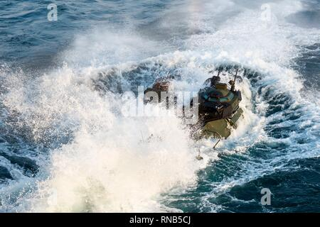 190216-N-DX072-1030 GULF OF THAILAND (Feb. 16, 2019) – An assault amphibious vehicle (AAV) assigned to 31st Marine Expeditionary Unit (MEU) departs the well deck of the amphibious transport dock ship USS Green Bay (LPD 20) enroute to the Royal Thai Navy landing platform dock ship HTMS Angthong (LPD 791) in preparation for an amphibious exercise. Green Bay, part of the Wasp Amphibious Ready Group, with embarked 31st MEU, is in Thailand to participate in Exercise Cobra Gold 2019. Cobra Gold is a multinational exercise co-sponsored by Thailand and the United States that is designed to advance reg - Stock Photo