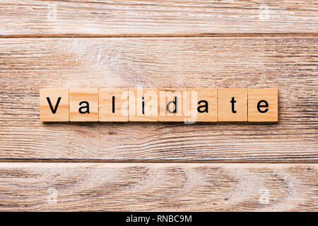 VALIDATE word written on wood block. VALIDATE text on wooden table for your desing, concept. - Stock Photo