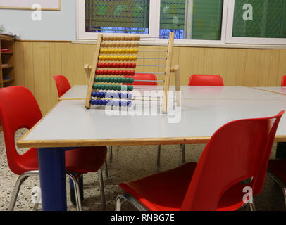 interior of a school classroom with wooden abacus above the table to teach children to count - Stock Photo