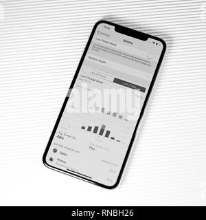 PARIS, FRANCE - SEP 27, 2018: new iPhone Xs Max smartphone model by Apple Computers close up with battery and activity screen time stats app showing phone usage - black and white - Stock Photo