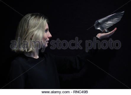 Bonhams member of staff holding a 'Victoire' car mascot, designed in 1928 and valued between £10,000-£15,000, during a photo call for a private collection of masterpieces by glassmaker Rene Lalique before it is offered at auction at Bonhams in London. - Stock Photo