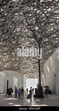 An unusual dome construction made of 8,000 metal stars spans the Louvre Abu Dhabi. Beneath the striking eye-catcher of 180 meters in diameter, through which rays of light pass, is a building complex with 55 cuboid houses. (13 January 2019) | usage worldwide - Stock Photo