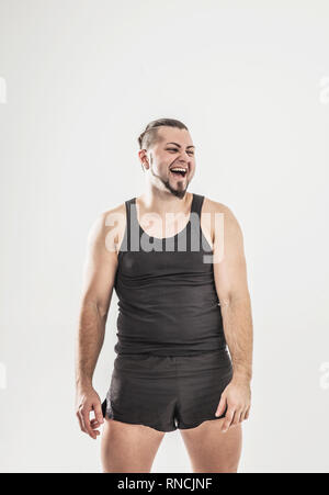 portrait of charismatic trainer on bodybuilding on a light backg - Stock Photo