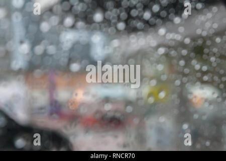 Image of raindrops on window wiht effect of bokeh - Stock Photo