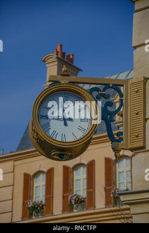 FRANCE, PARIS - February 27,2016 - View of a decorative clock in La Place de Remy at Disney Studios, Paris. Inspired by a Parisian neighborhood - Stock Photo