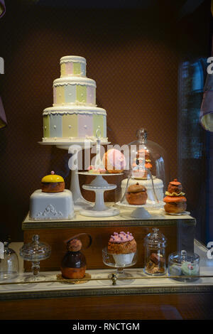 FRANCE, PARIS - February 27.2016 -showcase of a pastry shop, with several sweets and cakes to eat something,located in La Place de Remy, in Disneyland - Stock Photo