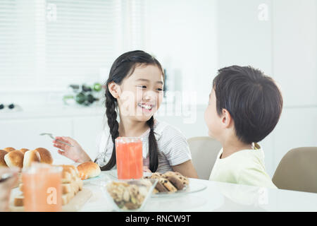 Sister and younger brother who breakfast - Stock Photo