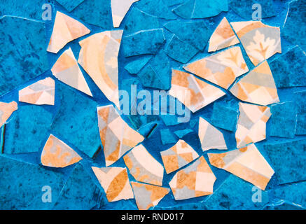 Original background, pieces of broken tiles, blue, turquoise and beige. Cracks, play of color, antiquity, vintage. - Stock Photo