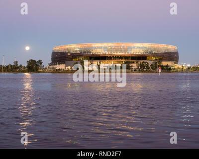 Moon rising over Perth Optus Stadium, Perth, Western Australia - Stock Photo
