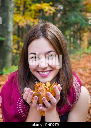 Pretty mesmerizing adorable teen girl portrait is smiling at camera giggle giggling spontaneous joy - Stock Photo