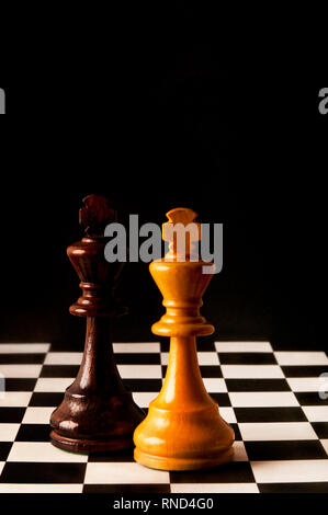 chess kings, black and white on the chessboard - Stock Photo