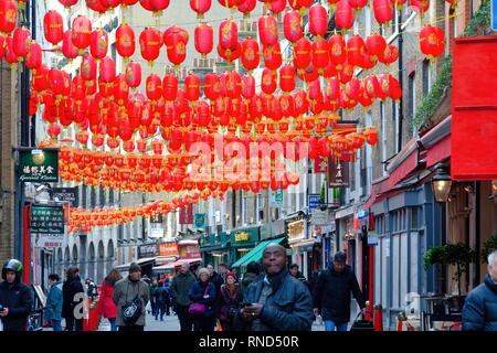 The Chinatown area in central London with the streets decorated with many red Chinese lanterns England UK - Stock Photo