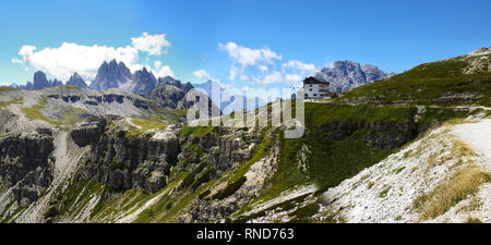 Wonderful view of the Dolomites - On background the view of Auronzo refuge (Italy): the starting point to get to the three Lavaredo's peaks. - Stock Photo