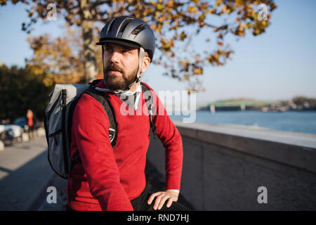 Hipster businessman commuter with bicycle traveling to work in city. - Stock Photo