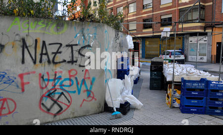 Anti-Jewish Nazi graffiti and swastika on a wall in the pilgrimage city of Ponferrada in the province of León, Spain. - Stock Photo