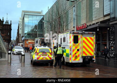 Glasgow, Scotland,UK 18th, February, 2019 Two ambulances and police car attend incident at the St Enoch centre shopping mal  in the city as a woman was seen being stretchered to hospital with life saving machine attached.  Gerard Ferry/Alamy Live News - Stock Photo