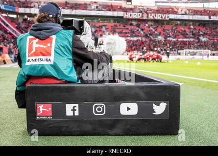Leverkusen, Deutschland. 18th Feb, 2019. Feature, Cameraman working behind a gang with social media buttons, TV, Media, Film, Watching TV, Soccer 1.Bundesliga, 22.matchday, Bayer 04 Leverkusen (LEV) - Fortuna Dusseldorf (D) 2: 0, on 17.02.2019 in Leverkusen/Germany. ## DFL regulations prohibit any use of photographs as image sequences and/or quasi-video ## ¬ | usage worldwide Credit: dpa/Alamy Live News - Stock Photo