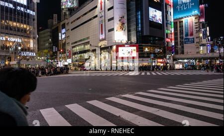 TOKYO, JAPAN - DECEMBER 23, 2012: Pedestrians cross at Shibuya Crossing. It is one of the world's most famous and busiest scramble crosswalks in the w - Stock Photo