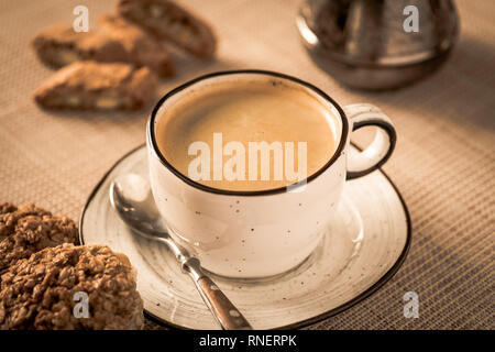 cup of hot coffee and cookies on a table. concept morning coffee - Stock Photo
