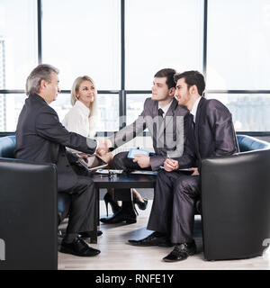 handshake business partners before beginning business negotiations on the background of applauding - Stock Photo