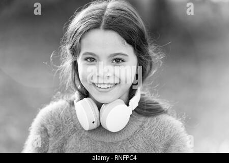 Its all about music. Little music fan on autumn day. Happy little girl in autumn. Little girl listen to music. Happy child with headphones. My mood just goes way up. - Stock Photo