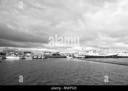 Reykjavik, Iceland - October 13, 2017: ships in sea port. Passenger vessels with longer journey in sea harbour. Blue sea water under cloudy sky. Get ready for a journey. - Stock Photo