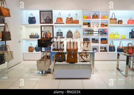NEW YORK - APRIL 06, 2016: Michael Kors store in JFK Airport. Michael Kors Holdings is an American luxury fashion company established in 1981 by desig - Stock Photo
