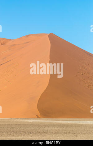 African landscape, beautiful red sand dunes called Dune 47 in the Namib Naukluft national park, Sossusvlei, Namibia - Stock Photo