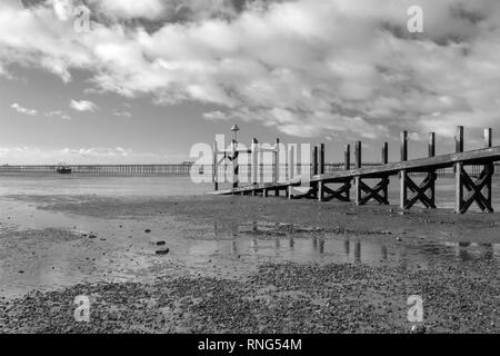 Black and white image of the Jetty on Jubilee beach, Southend-on-Sea, Essex, England - Stock Photo