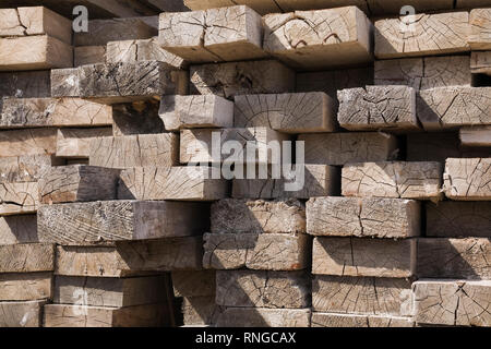 Stack of old timber in a lumberyard - Stock Photo