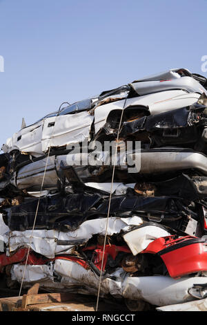 Tied stack of crushed automobiles on a flatbed transportation truck - Stock Photo