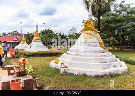 Kanchanaburi, Thailand - December 30, 2018: Three Pagodas (three small, stylized crumbling stupas) at Three Pagodas Pass is popular with tourists who  - Stock Photo
