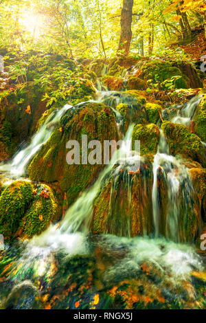 beautiful cascades in Plitvice lakes national park in forest on sunny autumn day, Croatia - Stock Photo