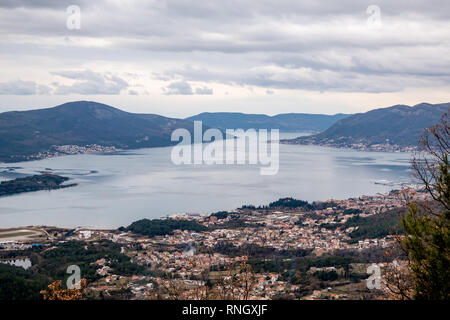 View of the Tivat side of Kotor Bay, and of Tivat village, from Vrmac moutain and fort. Montenegro. Winter landscape. - Stock Photo