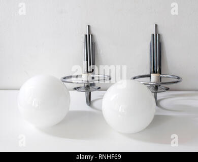 Two vintage wall lamps, chromed metal with large glass globe. Originals, Art Deco style - Stock Photo