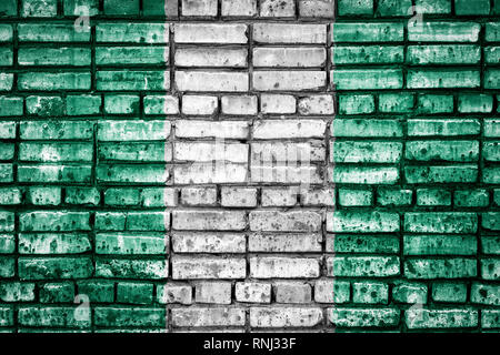 National flag of  Nigeria on a brick background. Concept image for Nigeria: language , people and culture. - Stock Photo
