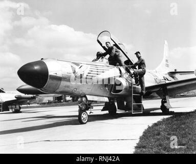 1958 - U.S. Air Force personnel assigned to the 119th Fighter Wing 'Happy Hooligans', North Dakota Air National Guard, Robert Groom and Neil Modin, photographed with their F-94 A/C Starfire aircraft at Hector Field, North Dakota. The 'Happy Hooligan' pilots flew the F-94 A/C Starfire aircraft from 1954-to-1960. - Stock Photo