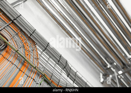 System of aluminum pipes at the food industry plant - Stock Photo