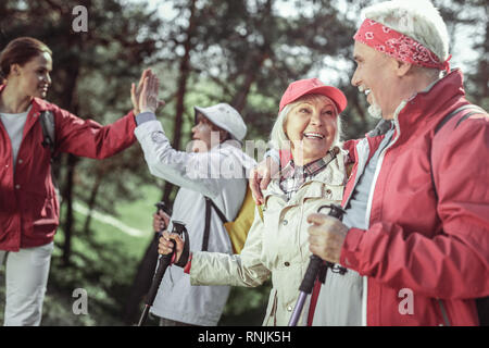 Old man giving five his sportive guide - Stock Photo