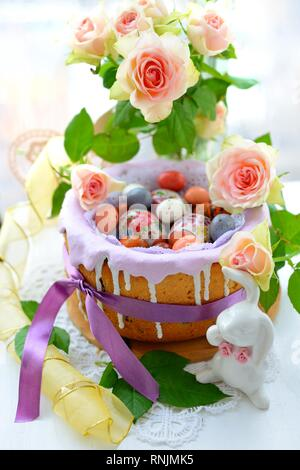 Easter decoration with eggs,rabbits and flowers - Stock Photo